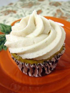 Pumpkin Cupcakes with Apple Butter Buttercream  adapted from Betty Crocker  (Printable Recipe)    1/2 cup finely chopped pecans (optional)  1 box yellow cake mix  1 cup canned pumpkin (not pumpkin pie mix)  1/2 cup water  1/3 cup vegetable oil  4 eggs  1 1/2 tsp pumpkin pie spice  1 cup caramel bits  Apple Butter Buttercream (recipe follows)
