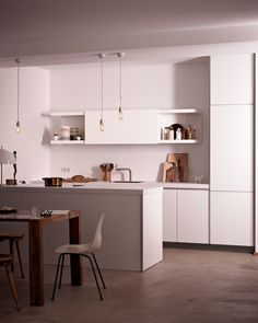 white bulthaup b1 kitchen with white aga oven exposed. Black Bedroom Furniture Sets. Home Design Ideas