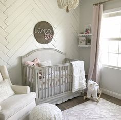 Once I found out I was having a baby girl, I knew I wanted to stay within the pink, gray and white color pallet with hints of gold. I had so many vision boards going for a not too girly or not too baby type of room. The first thing I knew I had to have was the chandelier and rug. I designed everything else around these two items. I always envisioned having more of a rustic style type furniture which would tie in nicely with the chandelier I found and our wood floors. This is now my favorite…