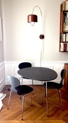 Black Arne Jacobsen Egg table and Ant chairs & Joe Colombo wall Coupe lamp