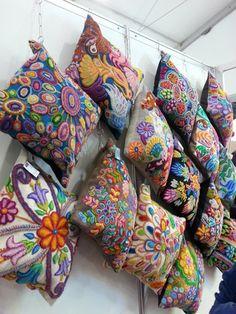 Beautiful hand-embroidered pillows at Peru Gift Show.  Shop it at disenobos.com.