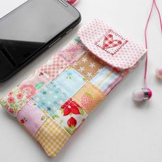 Mobile Phone Case - free tutorial by Cherry Heart. To change the size of the case just add an extra row of scrappy squares. This one is a gift.