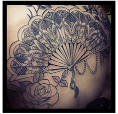 Beautiful Decorated Fan Tattoo in Black Ink
