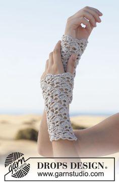 Delicate #crochet wrist warmers with fan pattern - new #free pattern by #garnstudio #ss2014