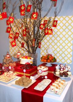 A perfect Chinese New Year buffet: moon cakes, lychee candy, haw flakes, sesame balls, and tree of wishes