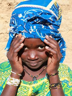 Africa | People.  Fatimah a young girl in Niger with the first letter of a her name tattooed between the eyes.
