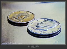 "A Sacagawea dollar coin and a Kennedy half dollar. I used a ""focus stacking"" technique to capture this macro. Around 10 shots at different focus points were combined to create maximum focus and sharpness of all elements. Prints at www.JNFineArt.com"