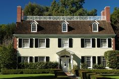 Colonial Home - A rectangular design, often characterized by double hung windows with multiple window panes,shutters, an overhanging upper story.