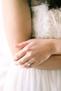 Pretty oval cut solitaire e-ring: http://www.stylemepretty.com/texas-weddings/buda-texas/2016/06/30/this-intimate-wedding-had-one-very-special-guest-a-donkey/   Photography: Kerry Jeanne Photography - http://kerryjeannephotography.com/