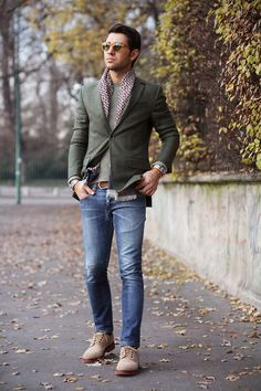 Choose a grey blazer and blue jeans for a dapper casual get-up. Dress it up with beige suede derby shoes.  Shop this look for $446:  http://lookastic.com/men/looks/sunglasses-crew-neck-sweater-blazer-belt-scarf-jeans-derby-shoes/4449  — Brown Sunglasses  — Grey Crew-neck Sweater  — Grey Blazer  — Brown Leather Belt  — White and Red Polka Dot Scarf  — Blue Jeans  — Beige Suede Derby Shoes