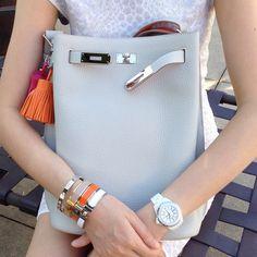 Hermes SO Kelly...H bracelets, and Carmen key holders, Chanel j12 diamond watch, Cartier love bracelet