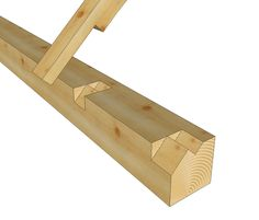 This details shows where a timber frame rafter joints the plate in a stepped lap…