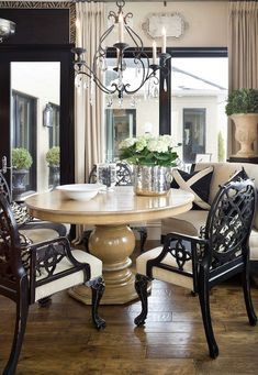 Joy Tribout - dining rooms - mushroom, linen, curved, bench, round, pedestal, dining table, black, dining chairs, iron, crystal chandelier, mercury glass, bucket,