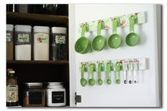 Measuring cup and spoon organization. Perhaps attach cushy drawer liner first to reduce banging sounds when opening cabinet door.