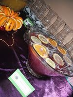 Mardi Gras Punch - non alcoholic: Mardi Gras Punch - Non-Alcoholic 1 bottle grape juice (40 oz) 1 container pineapple juice (48 oz) 1 (2L) bottle 7up or Sprite 2 oranges or lemons, sliced for garnish 2 limes, sliced for garnish  * it was listed to add 1/5 vodka (750 mL) is desired to make it alcoholic, but you can add a little malibu coconut rum instead.