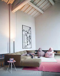 "Versatile tables with slender surfaces designed for ""lightweight living"""