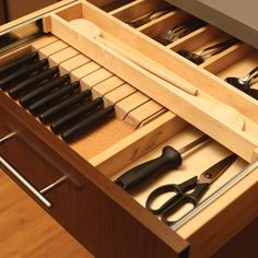 Love this double draw for utensils. Plus the knives are stored away safely.  Tips for Efficient Cutlery Storage | Sulekha Modular Kitchen