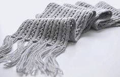 Free scarf pattern on Ravelry.  Looks like it might be reversible.  Very pretty.