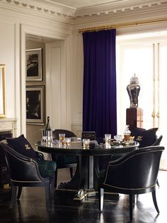 The Empire Pedestal Table & Duchess Dining Chairs create a world of smart, sophisticated style for the modern Duke and Duchess