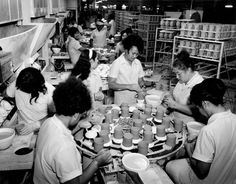 In the 1960s thousands of Pacific Island people immigrated to Auckland to fill labour shortages. Many found jobs in local industries, including the Crown Lynn ceramics factory in West Auckland. These workers are fettling greenware coffee mugs for glazing and firing.