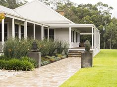 Modern Australian Homestead - wraparound verandah, french doors and double-hung windows onto veranda.