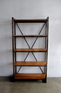 Second Charm: Tall metal rack with solid teak wooden shelf. $950. Almost exactly what I'd get for books cum divider between living/dining areas