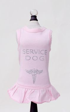 The Hello Doggie Service Dog dress is outfitted with enough shimming crystals to spell out Service Dog and create the medical symbol. Your little gal will be a star in this high-quality, soft cotton d Girl Dog Clothes, Small Dog Clothes, Puppy Clothes, Dog Dresses, Cute Dresses, Pet Style, Designer Dog Clothes, Dog Sweaters, Service Dogs