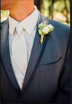 Succulent & Floral boutonniere. Design by Nina with By Request.  www.byrequest.us