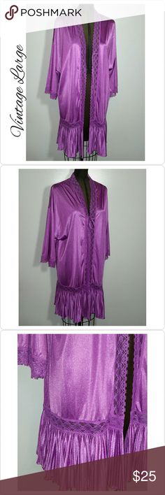 """Vintage Large Kimono Robe Gilead True vintage kimono robe by Gilead. Purple nylon. Ties in the front. Beautiful accordion ruffle hem. Lace trim down the front and on sleeves. Only issue I see is a small spot on one shoulder. Not noticeable. Look at 5th photo, center. Other than that it looks great. Could be worn by sizes small, medium and large. Beautiful as a cover up for swim wear. Or wear as a unique kimono with jeans etc, Bust measurements taken when tied, 48"""". Shoulder to hem 34"""". Smoke…"""