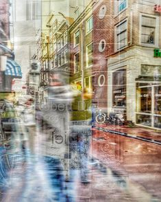 Abstract impression, after rain showers, of Halvemaansteeg in Amsterdam. | by Robert Diel