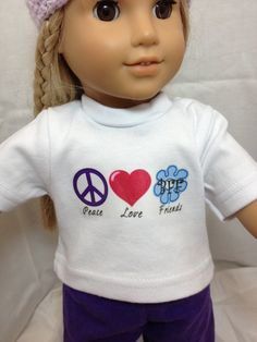 """White T-shirt with Peace, Love BFF (flower) design. Peace sign is purple, heart is dark pink and flower is blue. Pajama pants are purple and made from flannel material. Fits and 18"""" doll."""