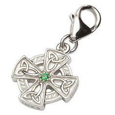 This beautifully adorned Silver Celtic Cross Charm is the essential gift for any Celtic Christian in your life. From our acclaimed Tara's Diary Collection, this charm displays four even beams, each intricately designed with the historical trinity knot symbol. The delicate cross sits atop a sterling silver circle and is accentuated by a perfect, centered emerald stone.Religious WearThe symbol of the Christian cross has long been a symbol for the love and sacrifice of Jesus. But, Celtic lore…