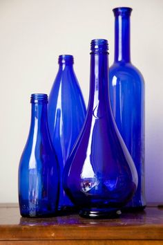 I have collected some blue bottles like these to put table flowers in. These particular ones are a set of 4 cobalt blue bottles/vases by DeSnorPhoto on Etsy, Blue Bottle, Bottle Vase, Blue Glass Bottles, Vintage Bottles, Bottles And Jars, Cobalt Glass, Cobalt Blue, Purple Glass, Pantone