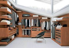 walk in closets with windows | Contemporary walk-in closet design with wood storage cabinets and ...