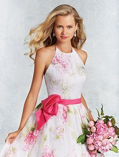 A beautiful floral print wedding gown with halter neckline, natural waist with side bow, ball gown skirt, and chapel train.