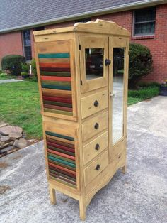 Old chiffarobe refinished using Annie Sloan Arles with dark wax. Used repurposed shutters on the side.