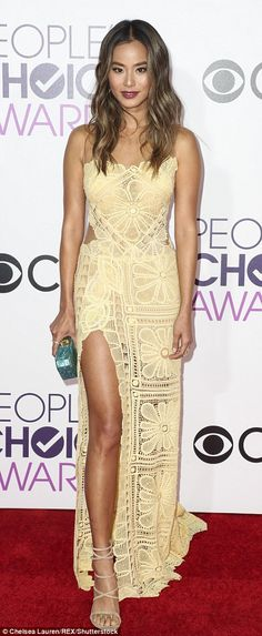 Pretty in pastel: Jamie Chung wowed in a soft yellow gown and beachy waved hair...