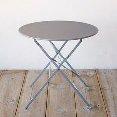 """Our favorite piece for outdoor entertaining, this café style table collapses for easy storage and transport, and comes in a rainbow of complementary hues that are perfect for mixing and matching. Topped with UV-resistant paint, the colors will remain bright and vibrant for years in the garden.- Powder coated steel- Indoor or outdoor use- Wipe clean with soft cloth and mild, non-abrasive detergent- Imported28""""H, 31.5"""" diameter"""