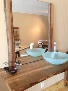 Vessel sink paired with the wood grain live edge reclaimed wood