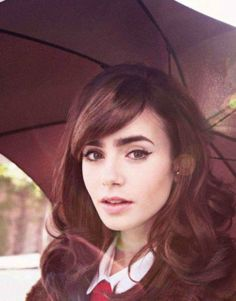 Lovely retro makeup on Lily Collins. #makeup #retro #cateye #lilcollins