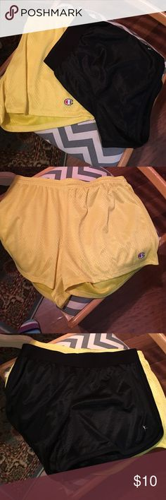 Two work out shorts Yellow champion size lg black danzkin size med both like new wore once Champion Shorts