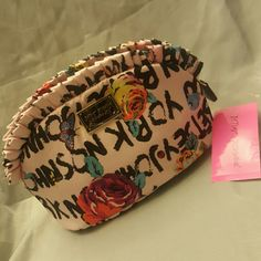 Ruffled makeup/travel bag Super cute makeup bag.  Fairly big to hold many things: in the last pic is my hand for size comparison. Betsey Johnson Bags Cosmetic Bags & Cases