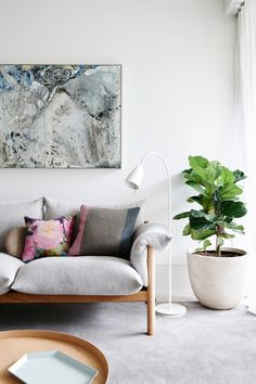 A clean backdrop allowed interior designers Hecker Guthrie to layer furniture, objects and art to achieve a balance of colour and lightness. photo: Eve Wilson | Vogue Living