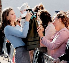 Queen Letizia with a baby in the town of Poreñu to deliver the Princess of Asturias Award for the Exemplary Town of Asturias. (21st of October 2017)