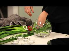Table Flower Arrangement Using A Fishbowl and some spear grass and tulips - budget friendly!