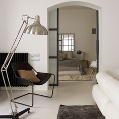 Adesso Atlas floor lamp accompanied by a beautiful chair and great interior colours