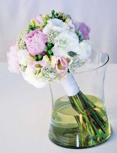 pink peonies, parrot tulips, rice flower, white hybrid rununculus, and green hypericum berries