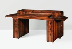 """AMBASSADE FRANÇAISE""  MODEL 'MB212', A RIO ROSEWOOD AND POLISHED STEEL DESK BY PIERRE CHAREAU, 1925"