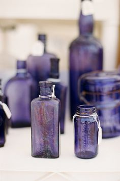 Purple glass could inspire an entire room. #flea-market http://www.stylemepretty.com/living/2014/09/10/stress-free-guide-to-flea-markets/ Photography: Ruth Eileen - rutheileenphotography.com