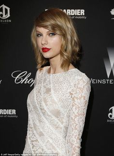 The 24-year-old country-pop starlet - who's recording her fifth album - rocked her signature red lipstick with her ladylike lace dress